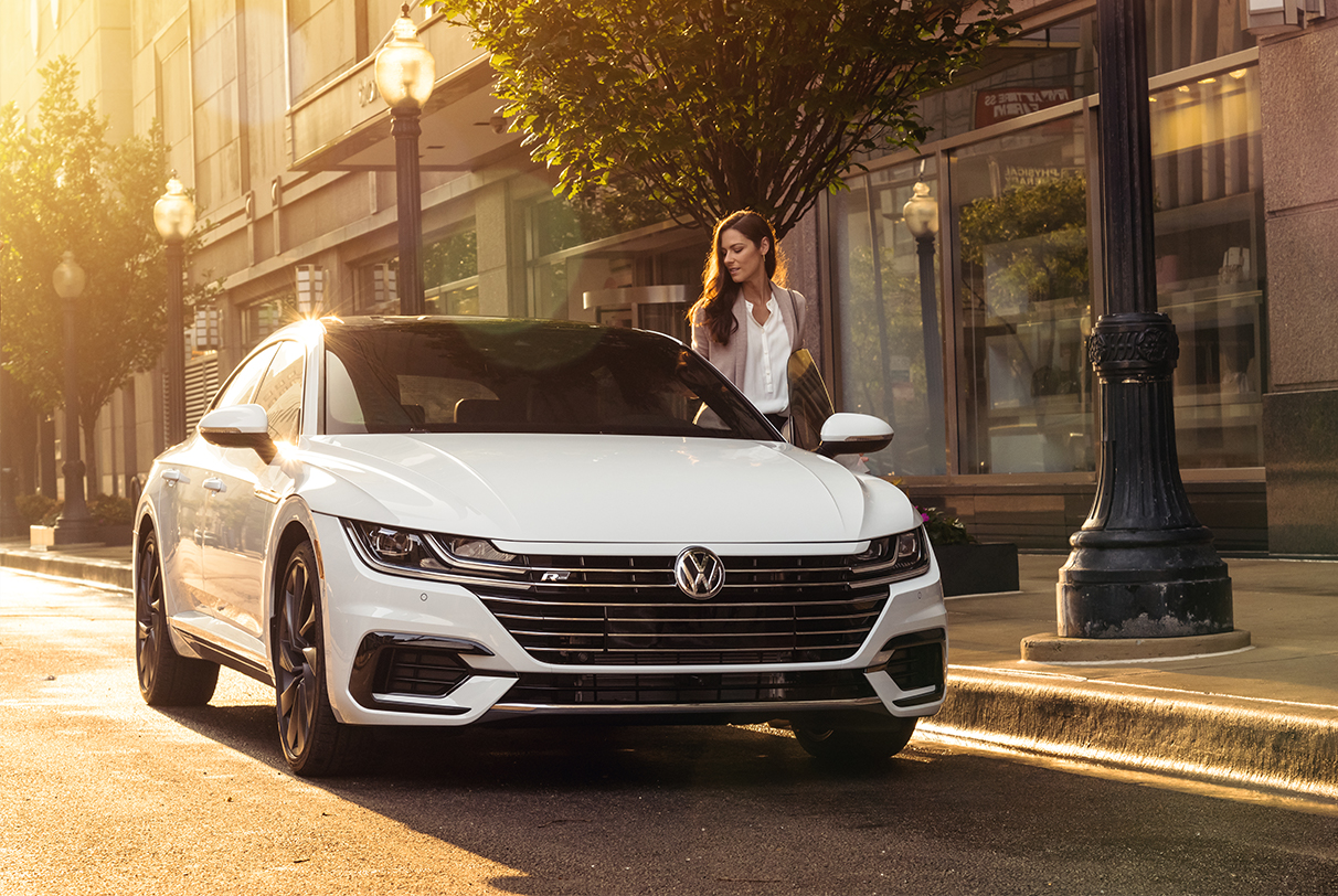 Woman entering Pure White Arteon