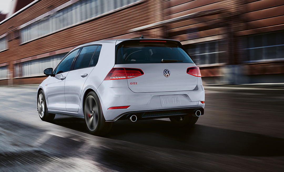 White Silver Metallic Golf GTI in motion, rear view