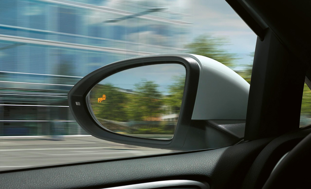 Side mirror showing Blind Spot Monitor