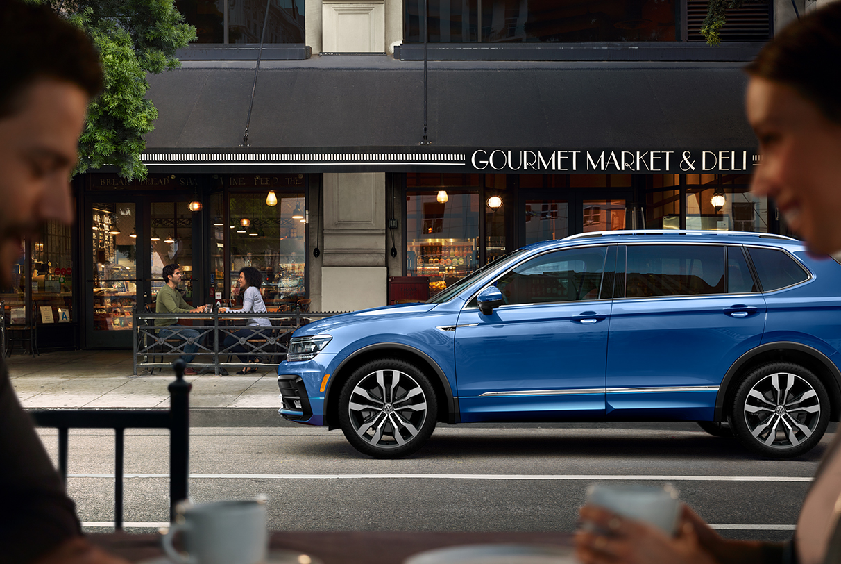 Silk Blue Metallic Tiguan parked in front of Gourmet Market & Deli