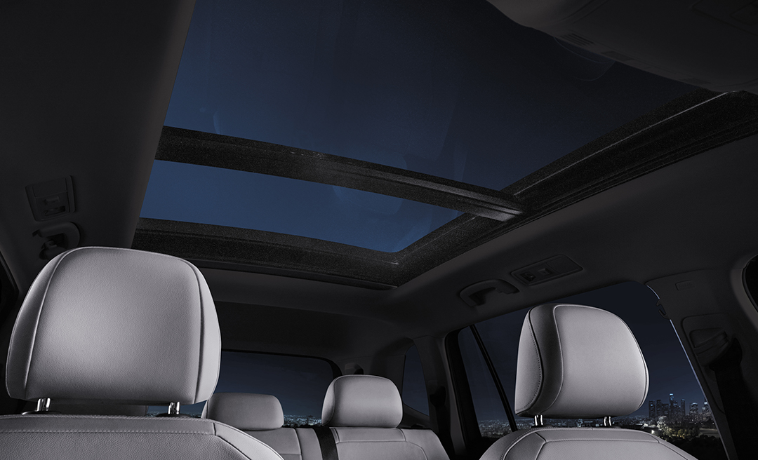 Interior with available panoramic sunroof open viewing stars at night