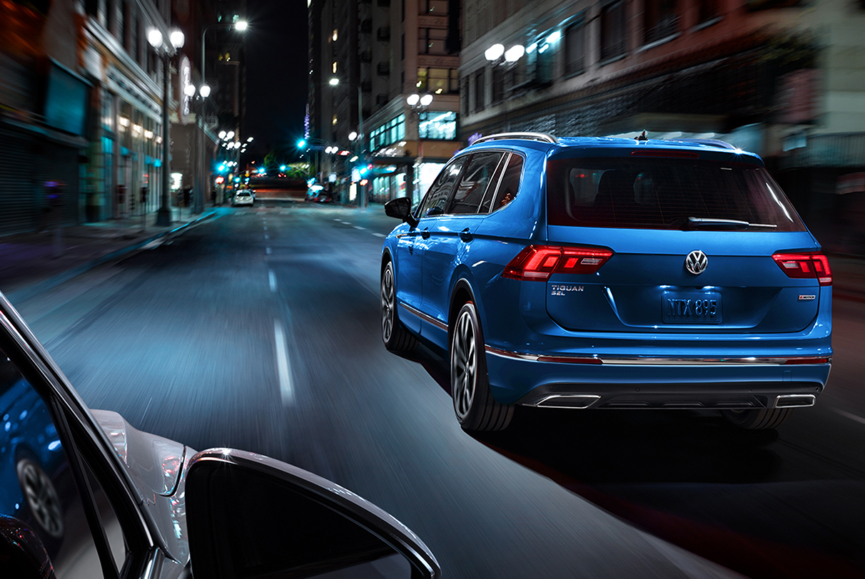 Silk Blue Metallic Tiguan rounding a turn