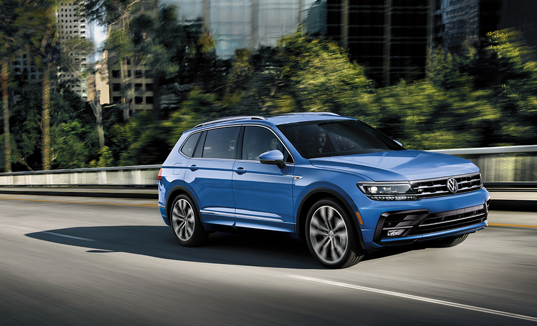 Silk Blue Metallic Tiguan in motion